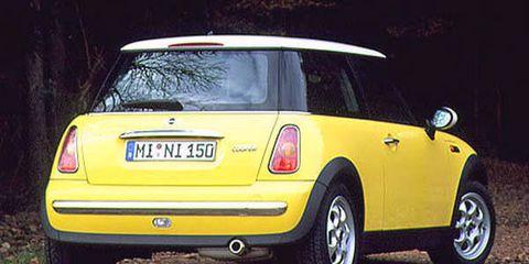 Motor vehicle, Automotive design, Mode of transport, Vehicle, Yellow, Land vehicle, Car, Automotive lighting, Automotive tire, Automotive parking light,
