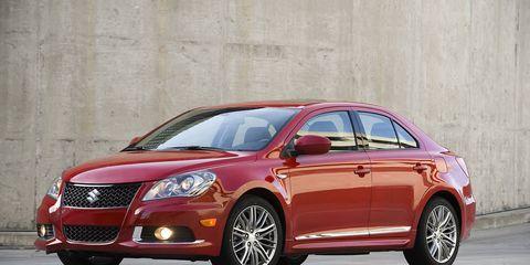Tire, Motor vehicle, Wheel, Automotive mirror, Vehicle, Automotive design, Land vehicle, Car, Glass, Red,