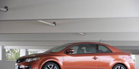 Tire, Wheel, Automotive design, Vehicle, Land vehicle, Automotive mirror, Automotive lighting, Car, Red, Automotive parking light,