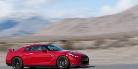 Tire, Wheel, Automotive design, Vehicle, Performance car, Hood, Automotive mirror, Car, Landscape, Rim,