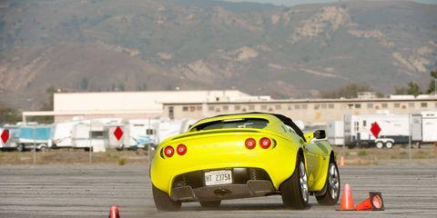 Automotive design, Mode of transport, Car, Performance car, Road surface, Asphalt, Cone, Automotive tire, Supercar, Auto part,