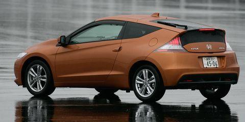 Tire, Wheel, Mode of transport, Automotive design, Vehicle, Land vehicle, Car, Red, Automotive tire, Automotive wheel system,