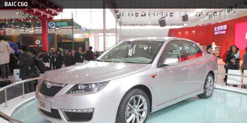 Mode of transport, Automotive design, Vehicle, Event, Land vehicle, Car, Glass, Auto show, Mid-size car, Full-size car,