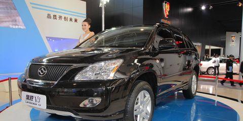 Motor vehicle, Automotive design, Land vehicle, Vehicle, Event, Car, Grille, Technology, Automotive lighting, Glass,