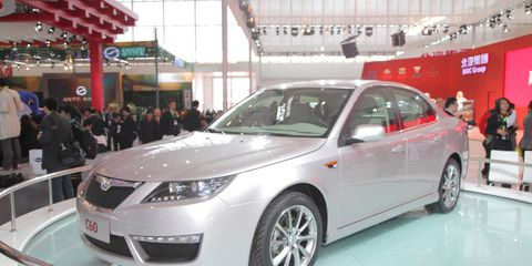Motor vehicle, Mode of transport, Vehicle, Event, Automotive design, Land vehicle, Car, Glass, Mid-size car, Full-size car,