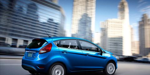 Motor vehicle, Tire, Wheel, Automotive design, Mode of transport, Blue, Vehicle, Automotive tire, Automotive wheel system, Automotive mirror,