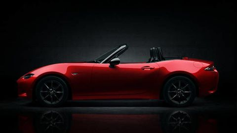 Automotive design, Vehicle, Red, Car, Convertible, Roadster, Fender, Sports car, Alloy wheel, Glass,