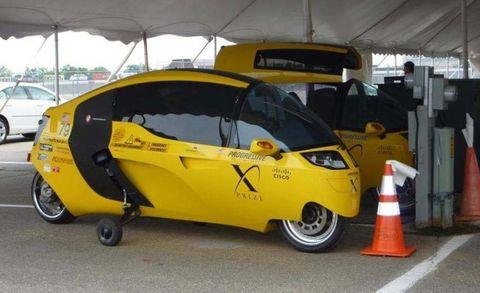 Motor vehicle, Wheel, Tire, Mode of transport, Automotive design, Yellow, Vehicle, Automotive tire, Transport, Automotive mirror,