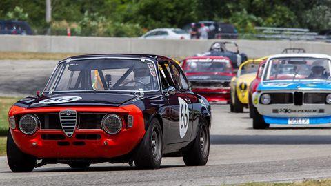 Vehicle, Land vehicle, Automotive design, Car, Motorsport, Classic car, Grille, Racing, Sports, Race track,