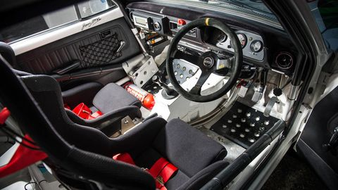 Motor vehicle, Steering part, Mode of transport, Steering wheel, Automotive design, Center console, Car seat, Speedometer, Gauge, Car seat cover,