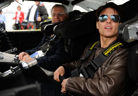 DAYTONA BEACH, FL - FEBRUARY 15: Actor Tom Cruise and father-in-law Martin Joseph Holmes prepare to drive the car that was used in the film 'Days of Thunder' prior to the NASCAR Sprint Cup Series Daytona 500 at Daytona International Speedway on February 15, 2009 in Daytona Beach, Florida. (Photo by Rusty Jarrett/Getty Images for NASCAR)