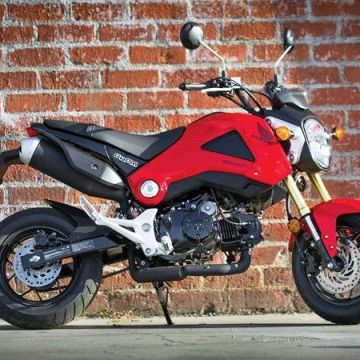 """<span style=""""font-size:11pt&#x3B;""""><strong>Base Price:</strong></span> $2999<br /><br />Honda's tiny new Grom is already gaining a cult following. It's just so darn cute. The 125-cc minibike may look like a downsized sportbike, but, though it can hit 55 mph, it really isn't fast enough for the freeway. This bike is best as a beachside cruiser. That's even where this featherweight got its name (a Grom is a young surfer kid). And that speaks to who Honda expects to be pining for the bike. <br /><br />But beyond the beach, the Grom is cool for anyone. We could see this bike as a very smart alternative to a traditional scooter because it's roomy enough for a six-footer and packs way more fun. Best of all, the Grom is so compact it makes hauling the bike around relatively easy compared to, say, carrying Honda's larger CBR250.<br /><br />"""