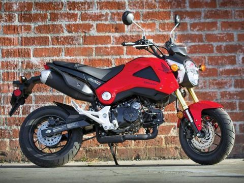 "<span style=""font-size:11pt;""><strong>Base Price:</strong></span> $2999 <br /><br /> Honda's tiny new Grom is already gaining a cult following. It's just so darn cute. The 125-cc minibike may look like a downsized sportbike, but, though it can hit 55 mph, it really isn't fast enough for the freeway. This bike is best as a beachside cruiser. That's even where this featherweight got its name (a Grom is a young surfer kid). And that speaks to who Honda expects to be pining for the bike.  <br /><br /> But beyond the beach, the Grom is cool for anyone. We could see this bike as a very smart alternative to a traditional scooter because it's roomy enough for a six-footer and packs way more fun. Best of all, the Grom is so compact it makes hauling the bike around relatively easy compared to, say, carrying Honda's larger CBR250. <br /><br />"