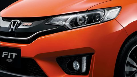 Motor vehicle, Automotive design, Automotive lighting, Vehicle, Headlamp, Hood, Grille, Car, Automotive exterior, Orange,