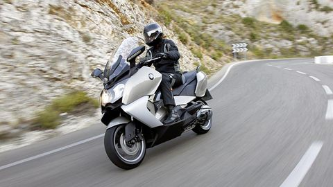 Motorcycle, Tire, Automotive design, Automotive tire, Motorcycle helmet, Road, Shoe, Automotive lighting, Helmet, Automotive wheel system,