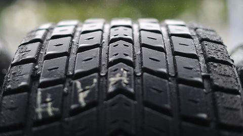 Automotive tire, Synthetic rubber, Tread, Automotive wheel system, Black, Carbon, Photography, Close-up, Symmetry, Macro photography,