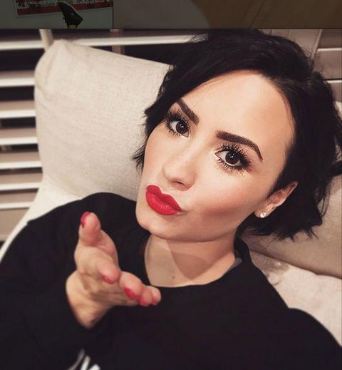 Nose, Finger, Lip, Mouth, Chin, Eyebrow, Eyelash, Eye shadow, Eye liner, Black hair,
