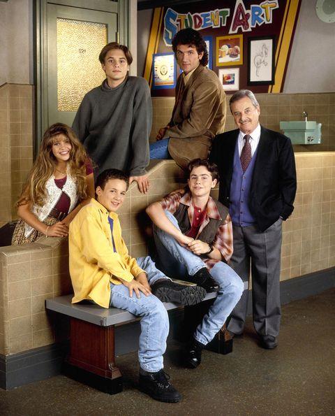 Trousers, Jeans, Coat, Shirt, Outerwear, Picture frame, Sitting, Jacket, Conversation, Blazer,