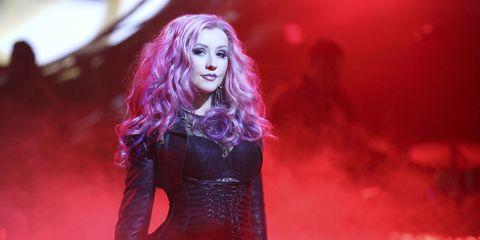 Mouth, Lip, Magenta, Purple, Long hair, Lipstick, Violet, Music venue, Red hair, Hair coloring,