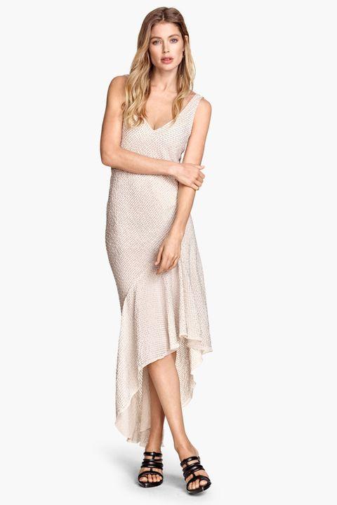 Sleeve, Shoulder, Dress, Human leg, Joint, Standing, One-piece garment, Elbow, Style, Formal wear,