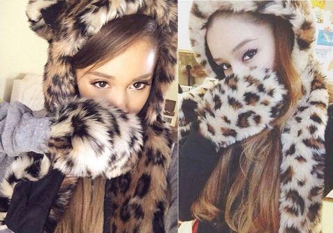 Human, Textile, Fur clothing, Style, Natural material, Iris, Eyelash, Fashion, Animal product, Brown hair,