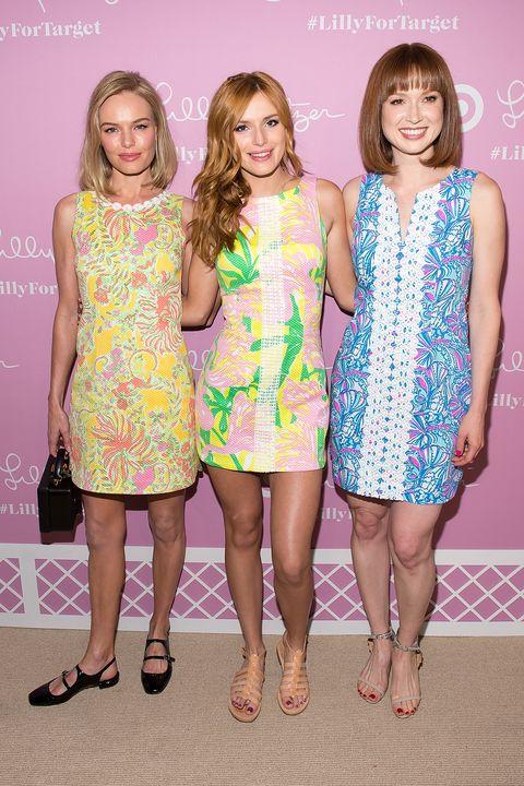 Clothing, Footwear, Leg, Yellow, Dress, Shoulder, Pattern, Pink, One-piece garment, Style,
