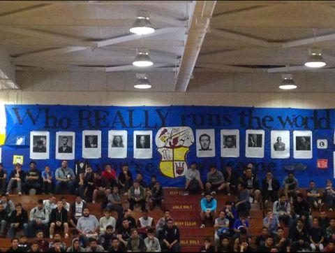 Human body, Ceiling, Crowd, Light fixture, Ceiling fixture, Audience, Hall, Basketball hoop, Beam, Fan,