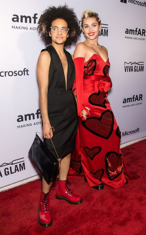 Tyler Ford and Miley Cyrus at the AMFAR gala