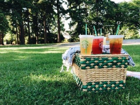 Basket, Storage basket, Wicker, Picnic basket, Lawn, Juice, Picnic, Fruit, Outdoor table, Home accessories,