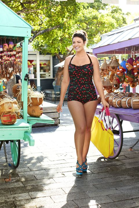 Public space, Bag, Street fashion, Bench, Luggage and bags, Thigh, Sunglasses, Market, Human settlement, Swimwear,