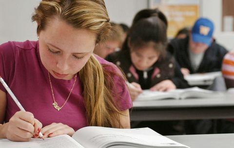 Female student using test prep book