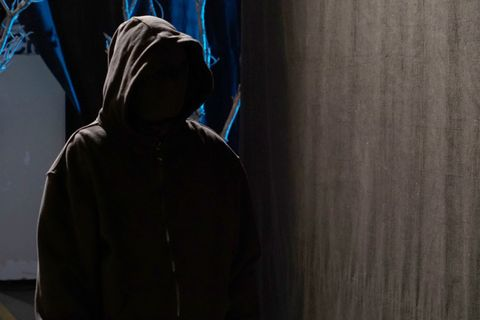 Hood, Darkness, Sweatshirt, Shadow, Fictional character, Hoodie, Mantle,