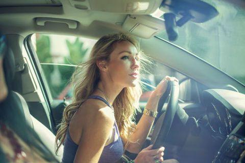 Vehicle door, Glass, Blond, Windshield, Head restraint, Car seat, Automotive window part, Aerospace engineering, Long hair, Family car,