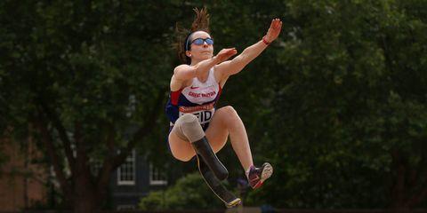 Sports uniform, Human leg, Jumping, Sleeveless shirt, Athletic shoe, Playing sports, Knee, Ball, Goggles, Track and field athletics,
