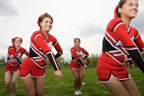 Sports uniform, Cheerleading uniform, Uniform, Jersey, Team, Beauty, Cheerleading, Sports jersey, Cheering, Stadium,