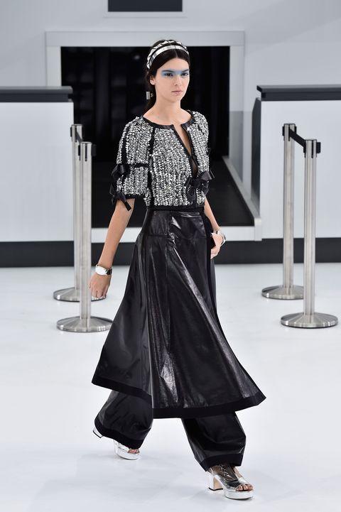 Fashion model, Clothing, Fashion, White, Black, Fashion show, Runway, Shoulder, Dress, Fashion design,