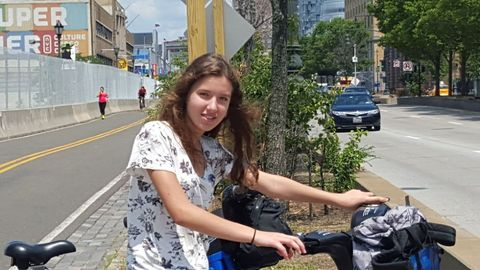Road, Bicycle handlebar, Neighbourhood, Asphalt, Urban area, Road surface, Bicycle accessory, Street, Bag, Bicycle part,