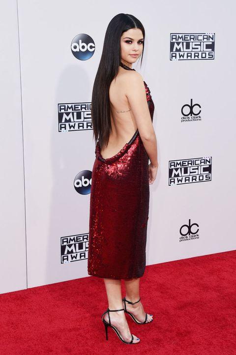 Shoulder, Dress, Flooring, Red, Style, Carpet, One-piece garment, Logo, Waist, Premiere,