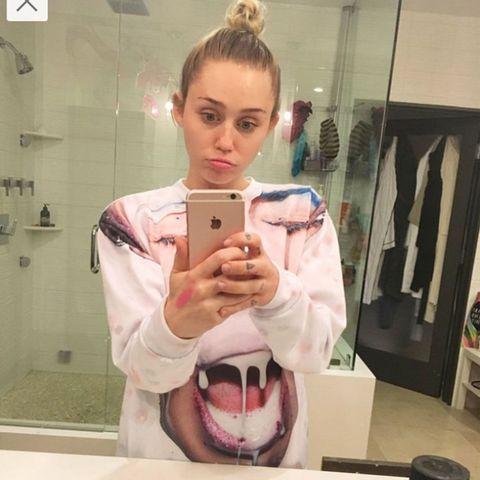 Selfie, Pink, Reflection, Mirror, Mobile phone, Eyelash, Blond, Portable communications device, Cameras & optics, Tongue,