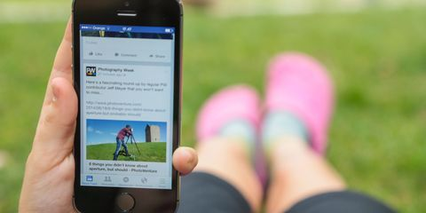 Girl using Facebook with pink shoes