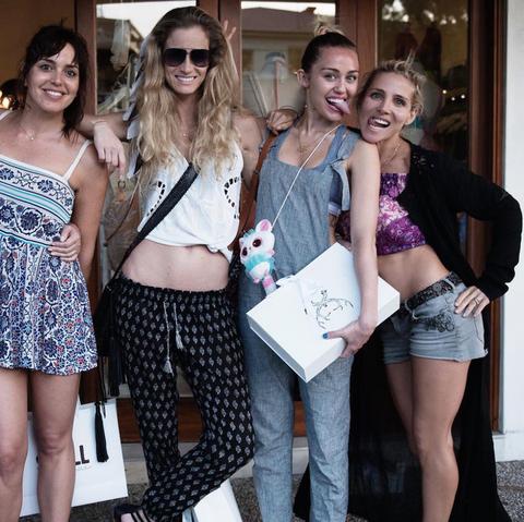 Clothing, Smile, Leg, Denim, Outerwear, Thigh, Sunglasses, T-shirt, Fashion accessory, Shorts,