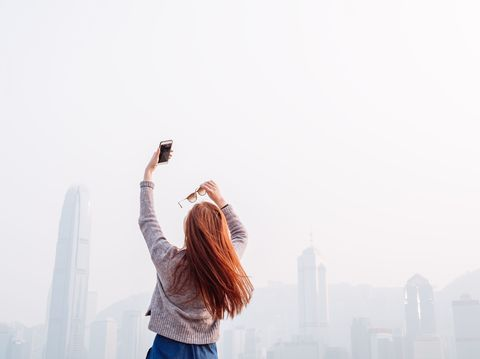 Atmospheric phenomenon, Denim, Tower block, Urban area, Travel, Metropolitan area, Metropolis, Haze, Street fashion, Mist,