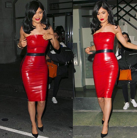 Clothing, Leg, Mouth, Dress, Human body, Shoulder, Red, Joint, Latex, Waist,