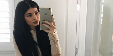 Finger, Hairstyle, Eyebrow, Mobile phone, Selfie, Fixture, Long hair, Beauty, Black hair, Portable communications device,