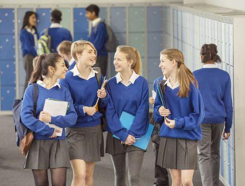 Uniform, Electric blue, Skort, Team, Thigh, Cobalt blue, Active shorts, Blond, School uniform, Employment,