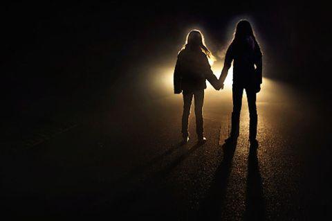 Standing, Darkness, People in nature, Backlighting, Night, Interaction, Light, Friendship, Love, Gesture,