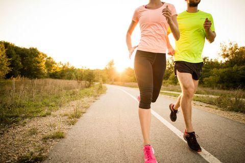 Clothing, Footwear, Leg, Road, Human leg, Asphalt, Athletic shoe, People in nature, Shorts, Sunlight,