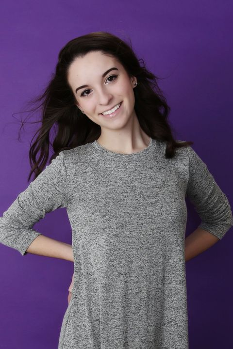 Clothing, Hair, Hairstyle, Sleeve, Human body, Shoulder, Purple, Joint, Elbow, Standing,
