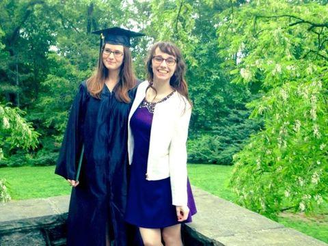 Smile, Academic dress, Sleeve, Green, Scholar, Mortarboard, Collar, Hat, Graduation, Formal wear,