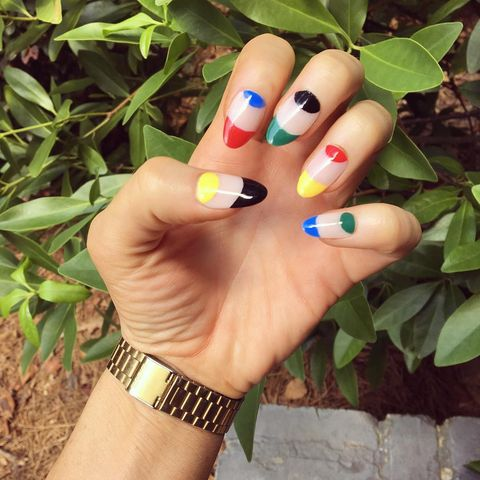 "<p>This negative nail design uses the official Olympics colors to paint the half moons and tips.</p><p><em>Design by </em><a href=""https://www.instagram.com/p/BIxsp31j96t/"" target=""_blank"">@ladie_evil</a></p>"